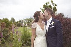Perfect kiss | Natalie J Weddings http://bridalmusings.com/2013/05/country-chic-diy-barn-wedding-natalie-j-weddings/