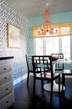 Love the black and white wallpaper and turquoise walls