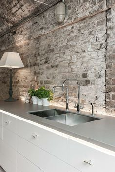 White brick backsplash for kitchen. Paint coat to appear more industrial ? Industrial light also nice White brick backsplash for kitchen. Paint coat to appear more indust White Brick Backsplash, White Brick Walls, Exposed Brick Walls, Kitchen Backsplash, Kitchen Cabinets, White Cabinets, Backsplash Ideas, Grey Walls, Rustic Cabinets