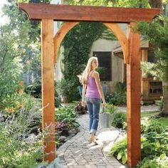 Build a Garden Arch: A small project that makes a big impression in your backyard.This classic garden arch has just six parts and can be built in less than a day. Create a gateway, frame a walkway in a hedge, or make it part of a trellis or pergola. Outdoor Projects, Garden Projects, Garden Ideas, Diy Projects, Garden Archway, Garden Entrance, Garden Arbor With Gate, Garden Gates And Fencing, Backyard Pergola