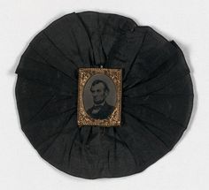 Rosette worn at A. Lincoln's funeral in Washington, D. C. by James J. Christie, Sergeant at arms in Capital at that time.