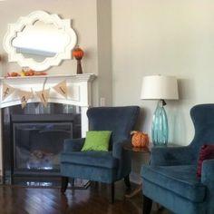 LaForce Be With You used Sherwin Williams Front Porch in their living room as well as in many other areas of their home. It's a nice light gray neutral and I love how it looks with those deep blue chairs. Thanks, Emily! #sherwinwilliamsfrontporch