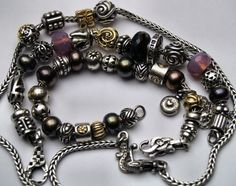 Lovely collection of museum/rare beads and clasps. Trollbeads.
