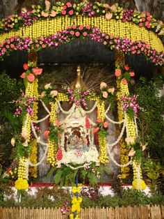 incredible decorations using flowers and fruit of a Krishna altar for Janmastami... wow!!!