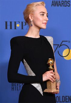 Saoirse Ronan poses with her award for Best Performance by an Actress in a Motion Picture Musical or Comedy in 'Lady Bird' in the press room during the 75th Annual Golden Globe Awards at The Beverly Hilton Hotel on January 7, 2018 in Beverly Hills,...