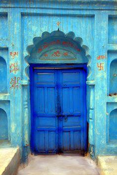 Vivid blue door in Orcha, India -  by dipperdoo