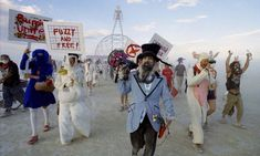 Rabbits run rampant at the annual Billion Bunny March, as Mein Hare (A.K.A. San Francisco performance artist $teven Ra$pa) wields his bullhorn and signature twin beards at Vault of Heaven, Burning Man, 2004