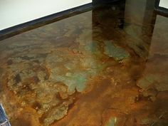 painted cement floors pics | Five colors were used in this stained concrete floor.