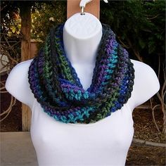 Black, Blue, Turquoise, and Purple Small Short INFINITY COWL LOOP SCARF, 50 x 4   Incredibly Soft, Warm, and Cozy Dark Multi-color Infinity Scarf hand-crocheted with a high quality acrylic yarn. Because of the cuddly softness, the scarf is incredibly comfortable and feels wonderful against the skin.   This is a petite winter scarf, meant to be worn as one or two loops, but it can also be worn as a small yet thick neck warmer as shown in the fifth photo.   The color in the photos is called…