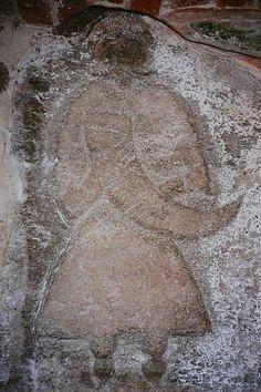 A priest of Svantevit, (a Slavic deity), or possibly Svantevit himself, depicted on a stone from Arkona, Germany, now in the church of Altenkirchen, on the island of Rugen, Mecklenburg-Vorpommern. Few relics from Slavic Paganism survive. This picture is from Wikipedia.