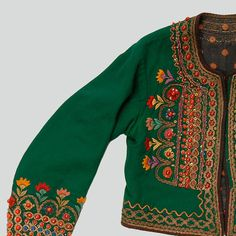 Woman's katana jacket of green wool. Decorated with haberdashery trimmings, ribbons, buttons, sequins, beads and embroidery. Trimmed with velvet and silk ribbon. Fastened with hooks and eyes. Hand and machine-sewn.    Western Krakowiak Folk, Zielonki, P. Kraków, 1920s (?)