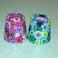 Handmade Millefiori Thimbles      The actual design is made entirely of slices of colorful polymer clay canes; no paints or other mediums have been used to create these beautiful, one of a kind collector's thimbles.