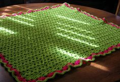 "Double V-Stitch Baby Blanket–Crochet Pattern ~ Skill Level: Easy   ~ Materials: 6mm & 5mm hook, 150g Green dk yarn.    ~ Measurements: 29.5"" x 29.5"" Notes: The double V-Stitch pattern can be used for various patterns and items scarves, cowls, shawls etc."