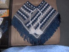 Crochet toddler poncho in Dallas Cowboys colors