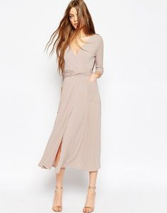 Be on the look out for this extremely classy wrap maxi dress.