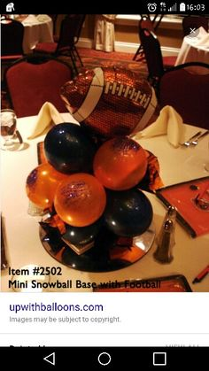 Balloon Centerpieces – Glittered Mini Snowball Balloon Base With Football - Up With Balloons. By Balloons From All Occasions Football Centerpieces, Banquet Centerpieces, Banquet Decorations, Balloon Centerpieces, Banquet Ideas, Ballon Decorations, Balloon Arrangements, Cheer Banquet, Football Banquet