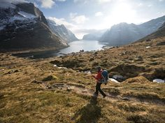 Snow-blanketed peaks, snug fishing harbors, white-sand beaches, and forests of evergreens make Norway's Lofoten Islands a hiker's delight. Located in the Norwegian Sea north of the Arctic Circle, Lofoten is popular especially in summer, when daylight lasts 24 hours a day. Photograph by Cody Duncan, Aurora, September 26, 2014