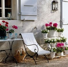 outdoor vignette in France with shutters and flowers
