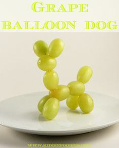 Grape balloon dog - perfect for a child's birthday party with a balloon artist as the entertainment