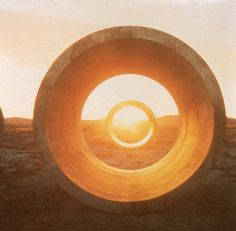 Nancy Holt's Sun Tunnels. Four large concrete tubes laid in the desert to align with the solstices and pierced by holes of corresponding with various constellations.