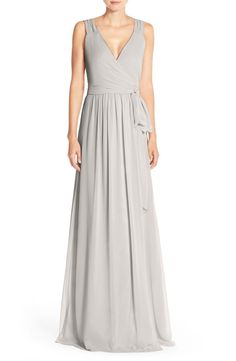 Wrap styling creates elegant flattery and custom-fit comfort for an enchanting chiffon gown topped with lavishly gathered straps that can be adjusted to form dainty cap sleeves.