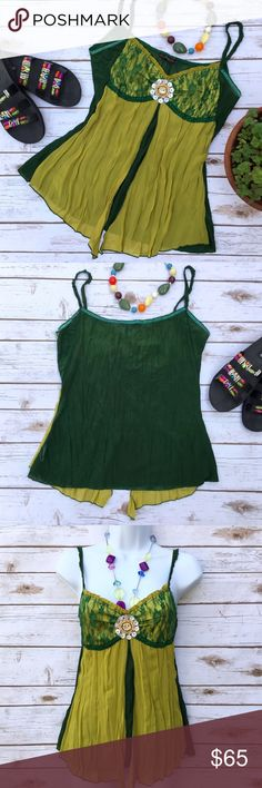 Hazel Festival Boho Embellished Tank Top with Lace Absolutely gorgeous top! Sheer, chiffon like panels over a dark green shell. Bust area has an additional layer of lace and beads and buttons embellishment. 100% polyester (the dark green fabric is stretchy). Size M, measures about 16 inches flat across from armpit to armpit (has some additional stretch) and about 24 inches in length. Hazel Tops