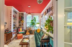 Eclectic Home Tour - Home Ec - Colorful family room with red ceiling, blue sofa and vintage decor - Family Room Colors, Family Room Design, Eclectic Gallery Wall, Eclectic Decor, Eclectic Design, Painted Interior Doors, Inside A House, Family Room Decorating, Decorating Ideas