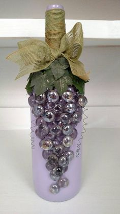 Large wine bottle painted a light purple. with jeweled grape design. #GiftsForWineLovers
