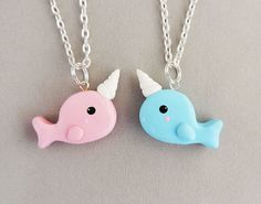 Narwhals swimming in the ocean! Share the narwhal love with your best friend! This set includes one pink and one blue narwhal necklace.   Each narwhal charm is completely handmade out of polymer clay, detailed with acrylic paints and finished with a glaze. Charm measures a little over 1 inch ac...