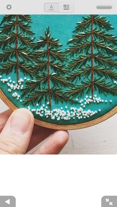 Snowy pine trees embroidery