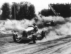 Photo Title  Into the Lead  Photographer/Creator  Wayne Bell  Collection  1948  Publisher  Minneapolis Tribune  Caption/Description  Emory Collins, national dirt track champion, maneuvers into the lead at the Minnesota State Fair races Aug. 28. Russ Lee's car, out of view at left, was so high Collins was able to cut inside and forge ahead. Mr. Bell selected this spot from which to shoot 'because of beautiful lighting and because most accidents occur here.'