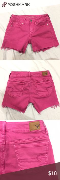 "American Eagle pink shorts Pink jean shorts. Has frayed hems on the bottom of the legs. Length: 11"", inseam: 5"", waist: 13 1/2"" across. In great condition. Feel free to make me a reasonable offer  American Eagle Outfitters Shorts Jean Shorts"