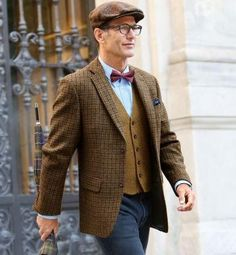 Shop this look on Lookastic:  http://lookastic.com/men/looks/flat-cap-dress-shirt-bow-tie-pocket-square-waistcoat-blazer-jeans/8789  — Brown Plaid Flat Cap  — Light Blue Dress Shirt  — Burgundy Polka Dot Bow-tie  — Charcoal Pocket Square  — Tan Wool Waistcoat  — Brown Check Wool Blazer  — Charcoal Jeans