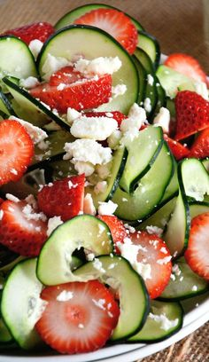 Cucumber Strawberry Poppyseed Salad Recipe ~ A refreshing and crisp salad with spiralized cucumbers, juicy strawberries and feta salad all topped with a fruity poppyseed dressing!