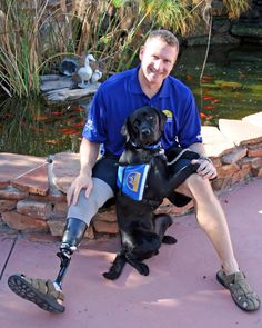 Major David Rozelle and his service dog.