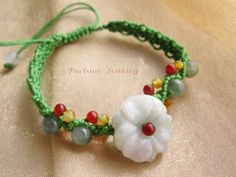 $24.99 Elegant Women White Blossom Flower Carved Jade Bracelet. Hand knotted Green cord with multicolored jade beads decoration - Fortune Jade Jewelry by Fortune Jewelry & Healing Beauty, http://www.amazon.com/dp/B00BGESZCE/ref=cm_sw_r_pi_dp_0xuLrb0WRV1R4