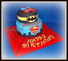 Super Hero Birthday - Superman, Batman & Spiderman inspired birthday cake.  Spiderman is a gumpaste figurine.