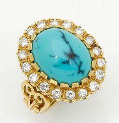 Ring mit Brillanten und Türkis750er GG, gestemp. 18 Brillanten zus. ca. 0,70 ct. (tw-w/vsi-si). 1 T