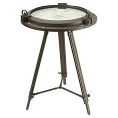 Featuring a functioning clock top, this imaginative wrought iron accent table showcases a tripod base and Roman numeral dial.  Product: