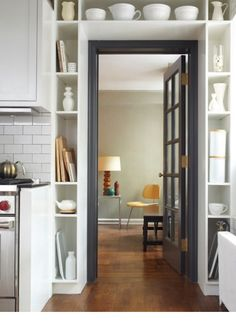 Clever Built Ins For Small Spaces   These Shelves That Fit Around A Door,  By Lauren Rubin Architecture, Are A Clever Way To Squeeze A Little Extra  Storage ...