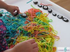 Learning to Count Sensory Bucket of Worms - searching for numbered rocks in colourful spaghetti.