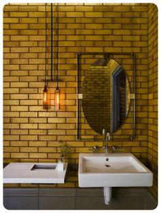 Gold metro or subway tiling on full bathroom wall