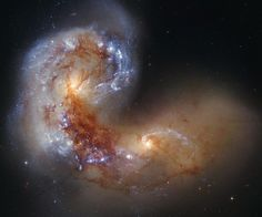 Spiral Galaxy NGC 4038 in Collision. A galaxy is a disruption in continuity which leads to a new form of organization. NGC 4038 is a disruption in that subsequent order.