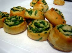 So easy and absolutely delicious. I urge you to try it! Miniature spinach parmesan puffs, made with croissant rolls!