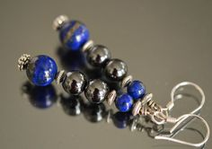 Check out this item in my Etsy shop https://www.etsy.com/listing/119574918/genuine-lapis-hematite-and-sterling