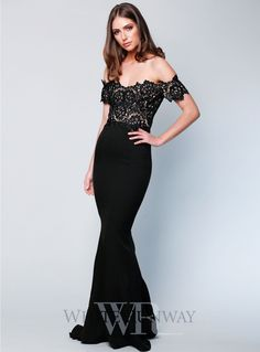 Monroe Dress. A beautiful full length dress by Elle Zeitoune. A fitted off shoulder style featuring a lace cut out bodice and floor sweeping train.