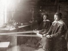 Man and woman make belts in the wooden hut. Saams. 1907. Norway Finnmark
