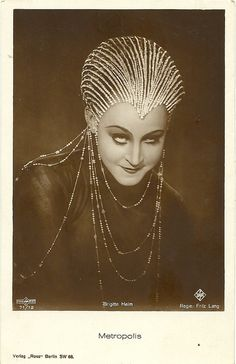 Brigitte Helm in Metropolis   German postcard by Ross Verlag, Berlin, no. 71/12. Photo: Ufa / Parufamet. Publicity still for (Fritz Lang, 1927). Collection: Didier Hanson.  German actress <b>Brigitte Helm</b> (1908-1996) is still famous for her dual role as Maria and her double the evil Maria, the Maschinenmensch, in the silent SF classic <i>Metropolis</i> (Fritz Lang, 1927). After <i>Metropolis</i> she made a string of over 30 films in which she ...