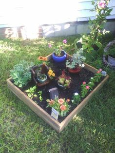 Created a no weeding required flower bed.  I took 3' long boards and nailed those boards to a 3' x 3' square of concrete board.  Placed the new flower bed (box) in the yard with the concrete board on the grass,  filled with soil, added my plants, and decor.