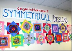 Students folded paper into eight sections, wrote their name in one triangle, and made a graphite transfer of the name onto each section. They then colored with markers and crayons. Students learned about symmetry, radial design, and color schemes.